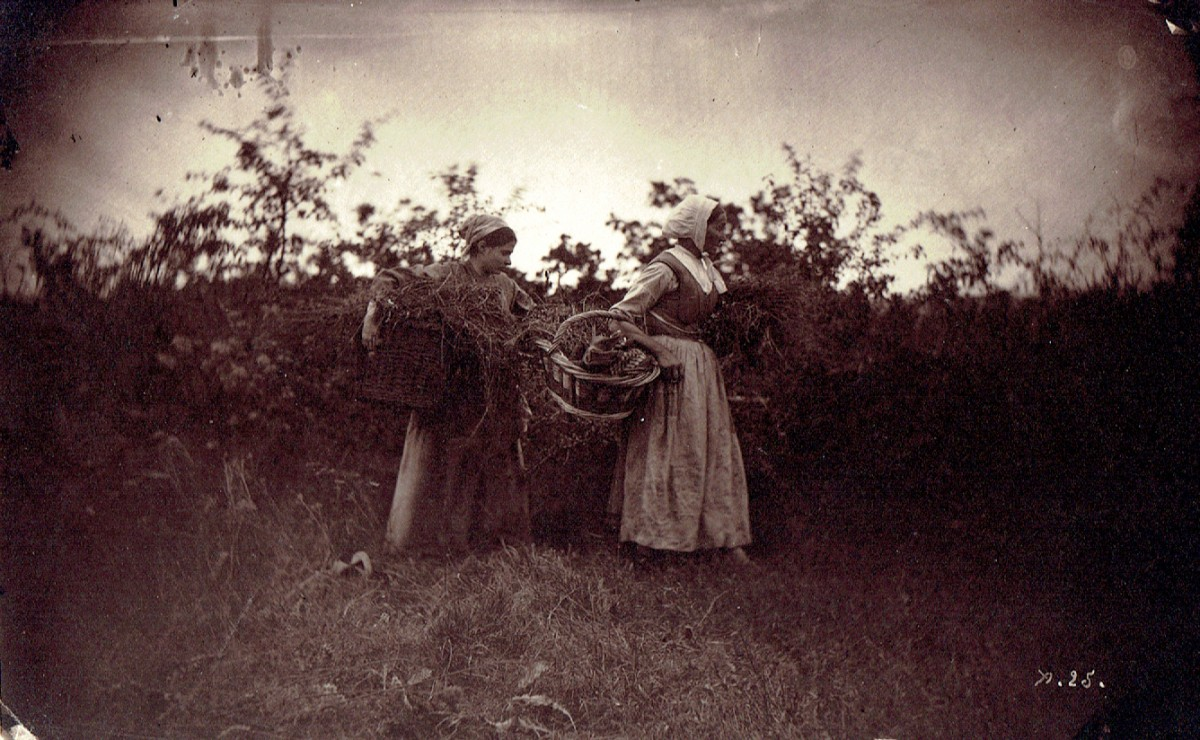 Two Women with Baskets in Field