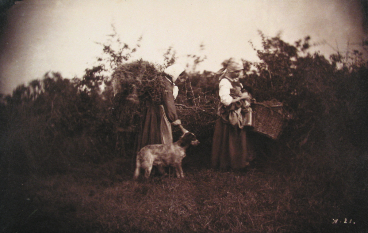 Two Women Standing with Baskets, with Dog
