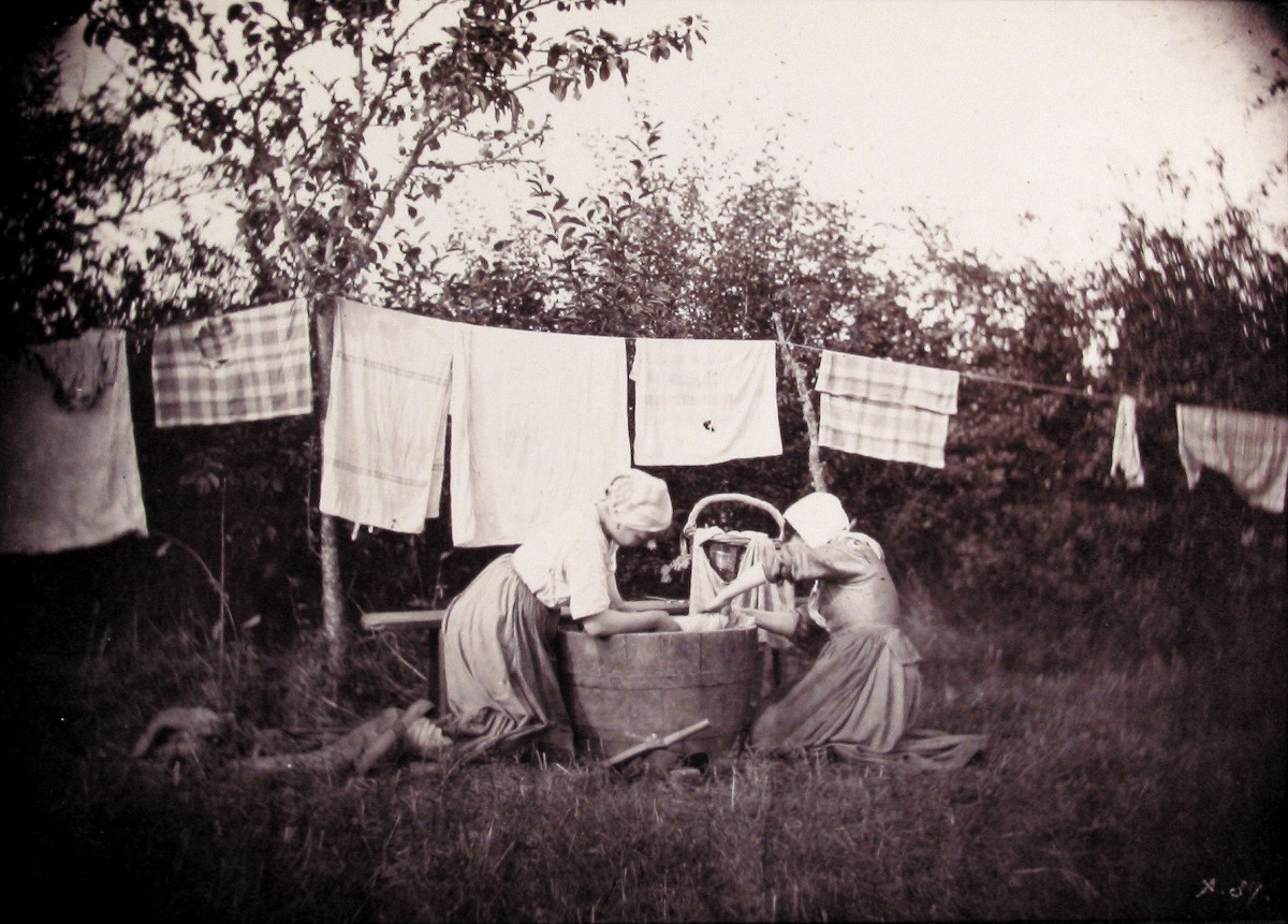 Two women doing laundry