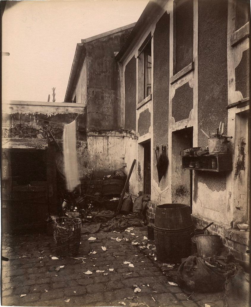 (courtyard with laundry and barrels)
