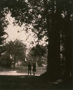 Two Gentlemen on a Road Under Trees